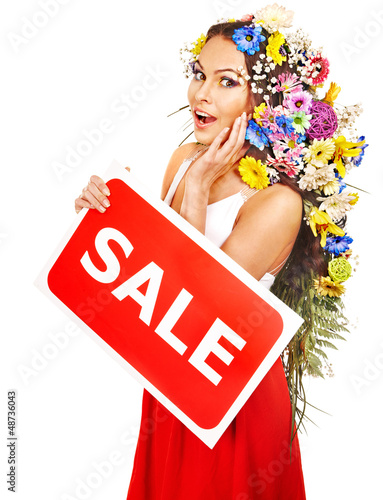 Woman holding sale banner and flower.
