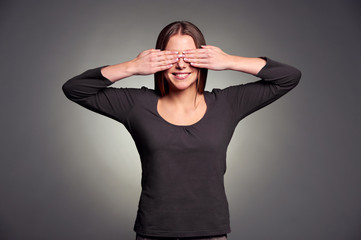 woman covering her eyes by hands