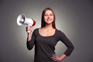 woman holding megaphone and smiling