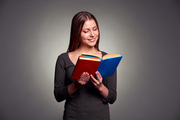 woman reading the book and smiling