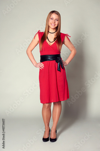 smiley woman in red dress