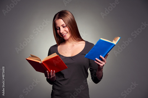 smiley young woman reading the books