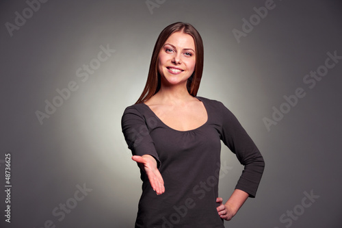 woman extending her hand for the handshake