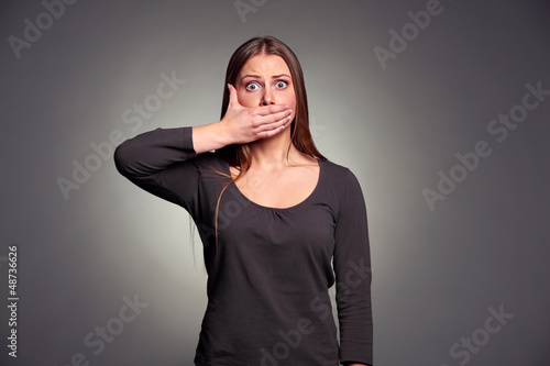 woman holding hand over her mouth