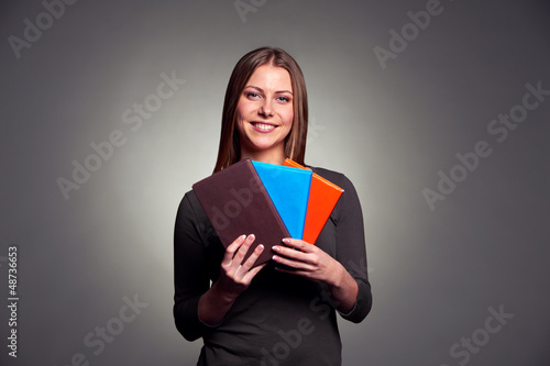 woman holding three books