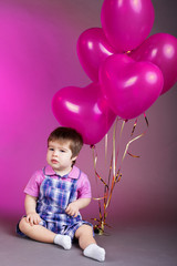 Little baby boy with pink balloons. Valentines day