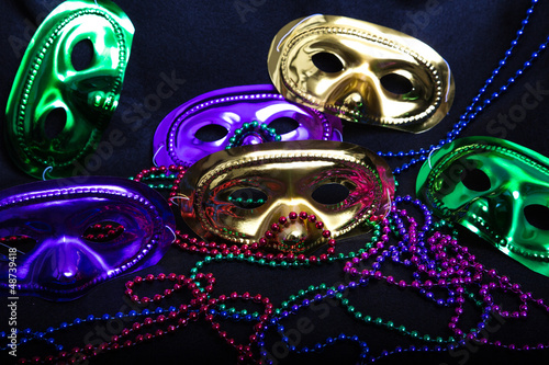Mardi Gras Masks and Beads on Black
