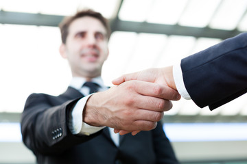 Image of business handshake at the office