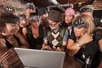 Biker Gang Interested in Nerd on Laptop