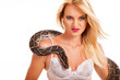 sexy blonde woman posing with python in studio