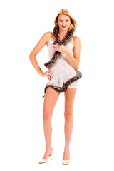 young woman in lingerie holding python isolated on white
