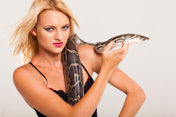 pretty young woman with python