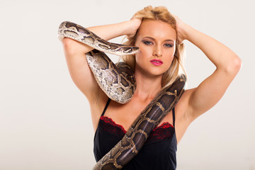 sexy young blonde woman posing with python