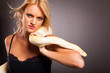 cool fashion woman holding python on her shoulder