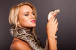 pretty young woman holding python