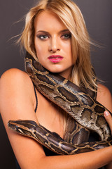 attractive young woman with python around her neck