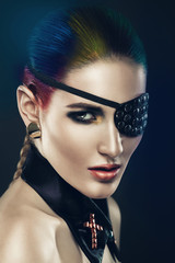 woman with coloured hair and eye-patch