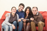 Happy Family on the Sofa with Digital Tablet