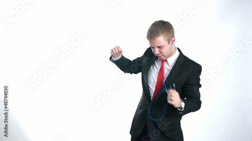 businessman dancing with the mobile phone