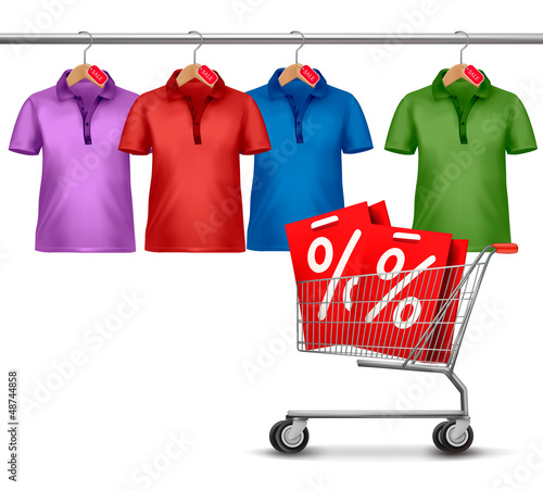 Shirts hanging on a bar and a shopping cart. Concept of discount
