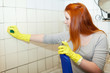 girl cleans bathroom with sponge