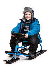 Child on snow scooter or snowmobile toy
