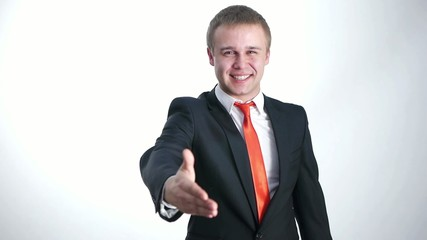 Businessman stretches out his hand to introduce himself