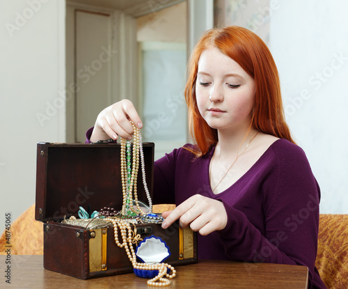 portrait of teen girl chooses jewelry