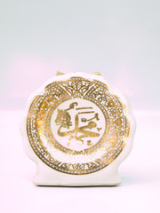 A Ceramic sign of Muhammad in golden Arabic caligraphy isolated