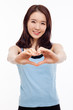 Beautiful Asian casual woman show heart shape.