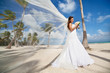 Beautiful caucasian bride posing at a tropical beach