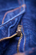 Macro Detail of a blue jeans zipper