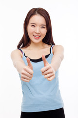 Young Asian woman showing thumb.