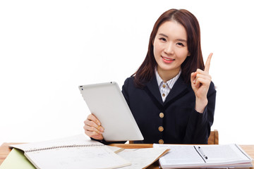 Young Asian student girl using tablet PC