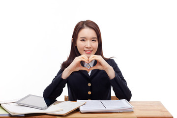 Young Asian student gesture heart shape.