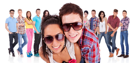 couple in front of a  group of casual fashion people