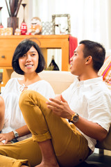Asian people couple in living room