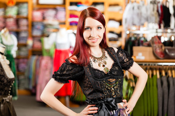 Woman is trying Tracht or dirndl in a shop