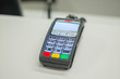 Credit card payment terminal on cash desk in mall