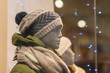 Mannequins in winter jackets and hats with scarfs and light bulb