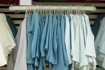 Fleece sweaters on stand in kids store