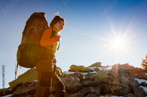 Hiker walking in autumn mountains