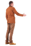 back view of business man in jacket out to shake hands.