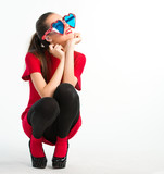 Young woman in red with heart shaped glasses