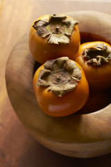 Persimmon In Wooden Bowl