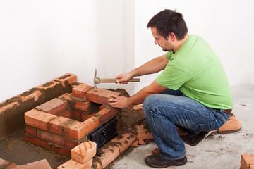 Man building fireplace