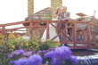bride and groom in garden posing on a wooden bridge