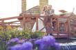 bride and groom in garden posing on a wooden bridge