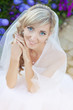 Wedding: close up portrait of beautiful blond bride