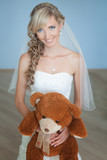 wedding: portrait of bride with a toy bear